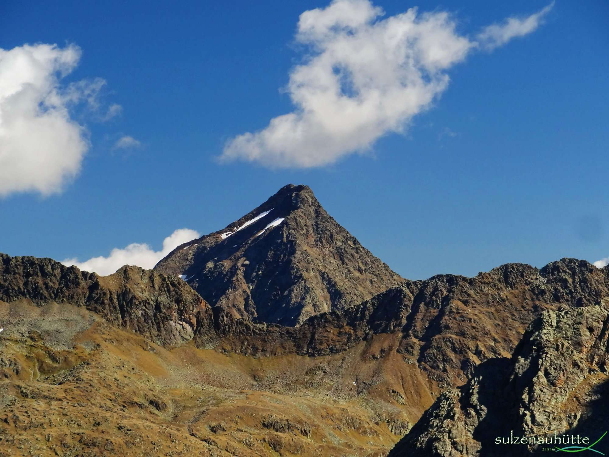 Blick aufs Niederl, darüber Aperer Feuerstein vom Peiljoch - Stubaier Höhenweg